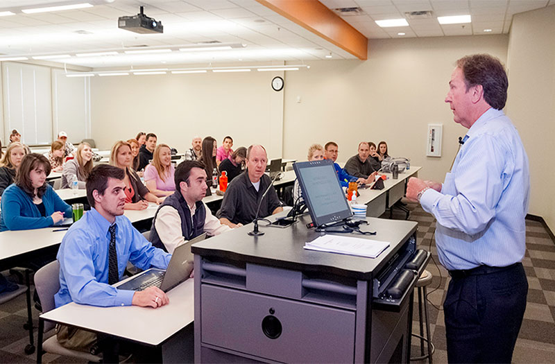 Professor giving CUKC students a lecture.