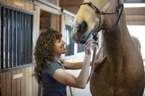 Dr. McLeod witwh one of her horse patients;
