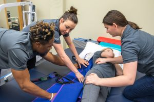 CUKC OTA students practice their skills;