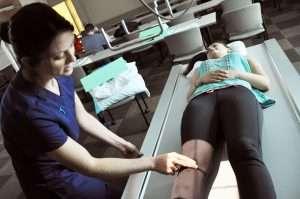 Rad teh performing an imaging exam;