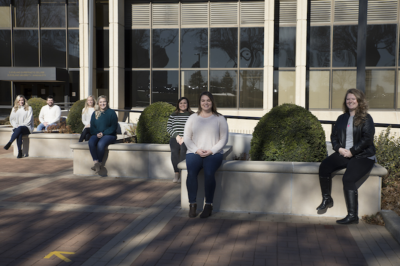 CUKC students standing on stairs outside.